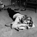 Jane Fonda Laying on the Her Apartment Floor Caressing her Siamese Cat